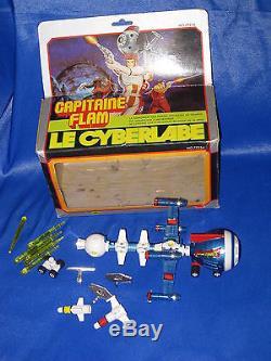 AC325 POPY LE CYBERLABE CAPITAINE FLAM TF1 1980 FRANCE Ref 77254 BON ETAT BOITE