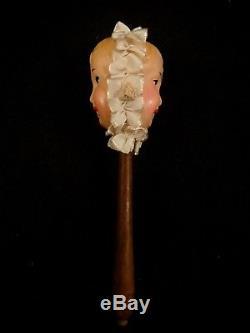 Ancien hochet bébé deux visages celluloïd bois TBE 1910 SIC Pièce de musée