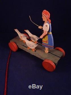 Ancien jouet animé à tirer meneuse d'oies en bois style Caran d'Ache 1930