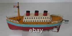 Ancien jouet bateau en tôle début 20° siècle à restaurer