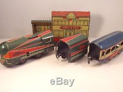 Ancien jouet coffret TRAIN ECLAIR CR 1952 mécanique tôle jouet la ville clé rail
