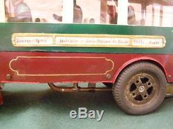 Ancien jouet en tôle Bus qui fonctionne avec une chaudière à eau