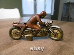 Ancienne moto en tole mécanique motard militaire DRGM
