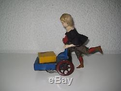 F MARTIN Jouet mécanique ancien le petit livreur