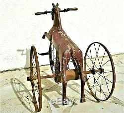Jouet ancien, cheval tricycle en bois et fonte d'époque fin XIX ème vers 1880