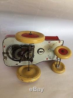 Jouet mécanique en tôle JRD Dubout 1949 tres bon etat