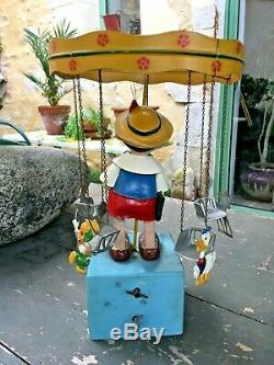 Manege caroussel musical pinocchio disney windup carousel music box