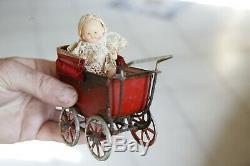 Rare jouet ancien petit landau + poupée ancienne miniature