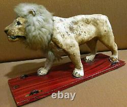 Sublime automate Victorien jouet ancien Lion tete hochante jouet a tirer 40cm