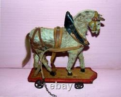 Superbe petit cheval en peau jouet Victorien c1880 sur roues de fonte PRIX R