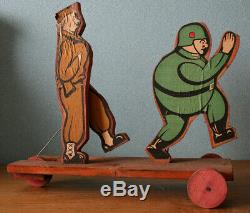 Très rare ancien jouet à tirer en bois vers les 1944/45